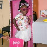 Young girl dressed as Barbie doll